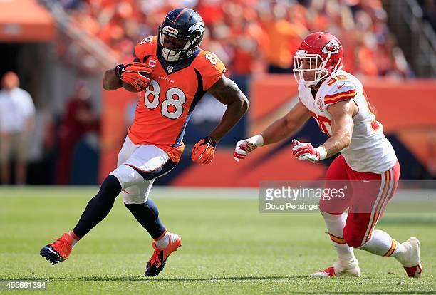 Wide receiver Demaryius Thomas of the Denver Broncos makes a pass reception against inside linebacker Josh Mauga of the Kansas City Chiefs at Sports...