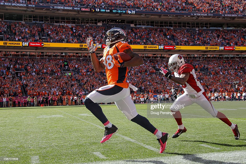 Wide receiver Demaryius Thomas #88 of the Denver Broncos out sprints free safety Rashad Johnson #26 of the Arizona Cardinals for an 86 yard touchdown in the second quarter of a game at Sports Authority Field at Mile High on October 5, 2014 in Denver, Colorado.