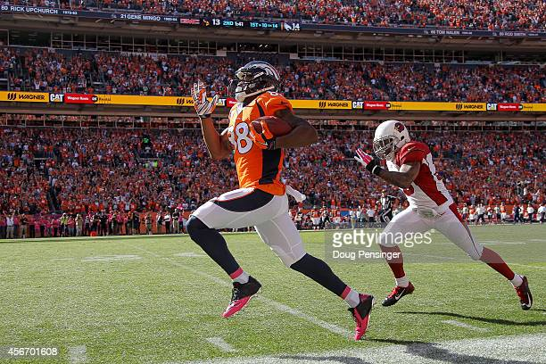 Wide receiver Demaryius Thomas of the Denver Broncos out sprints free safety Rashad Johnson of the Arizona Cardinals for an 86 yard touchdown in the...