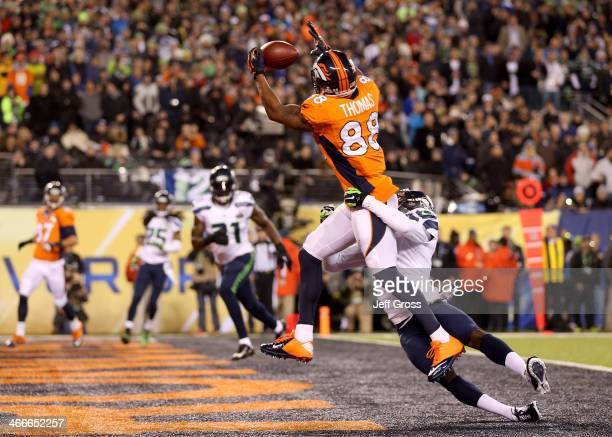 Wide receiver Demaryius Thomas of the Denver Broncos ran 14 yards to score a touchdown in the third quarter against cornerback Byron Maxwell of the...