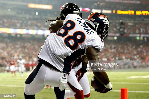 Wide receiver Demaryius Thomas of the Denver Broncos scores a touchdown in the second quarter against the Atlanta Falcons during a game at the...