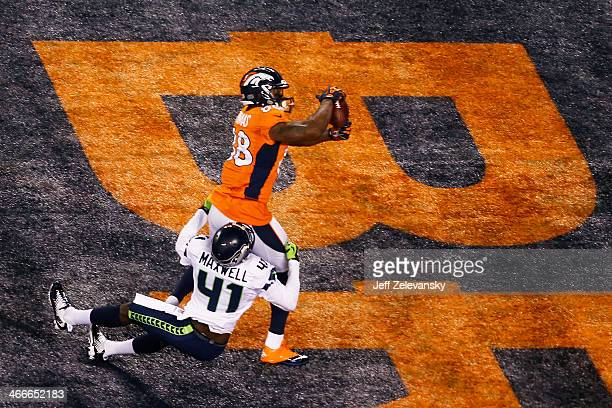 Wide receiver Demaryius Thomas of the Denver Broncos scores on a 14 yard pass during Super Bowl XLVIII against the Seattle Seahawks at MetLife...