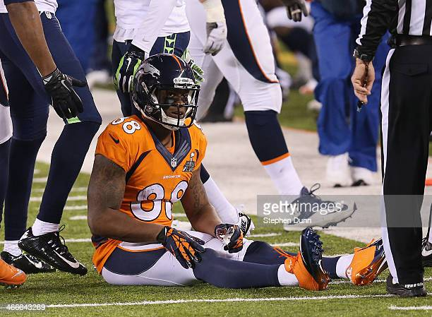 Wide receiver Demaryius Thomas of the Denver Broncos sits on the ground after fumbling the ball against the Seattle Seahawks in the third quarter...