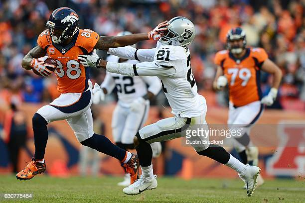 Wide receiver Demaryius Thomas of the Denver Broncos stiff arms cornerback Sean Smith of the Oakland Raiders in the third quarter of the game at...