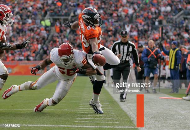Wide receiver Demaryius Thomas of the Denver Broncos stretches the ball towards the goal line but is knocked out of bounds by linebacker Derrick...