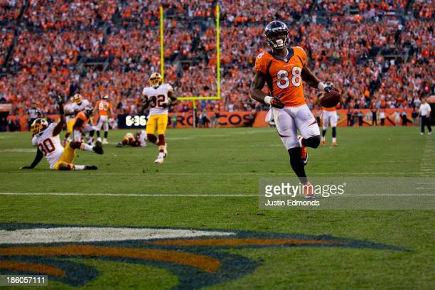 Wide receiver Demaryius Thomas of the Denver Broncos strides into the end zone for a 35yard touchdown reception during the fourth quarter against the...
