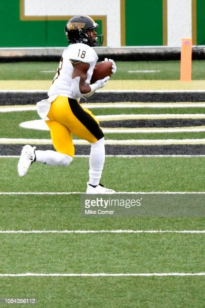 Wide receiver De'Michael Harris of the Southern Miss Golden Eagles makes a touchdown reception against the Charlotte 49ers during the football game...