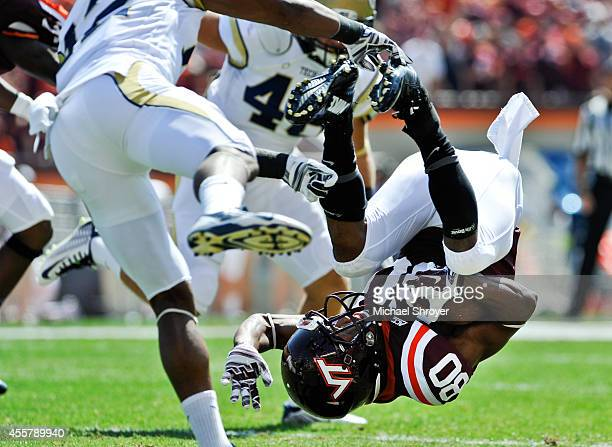 Wide receiver Demitri Knowles of the Virginia Tech Hokies gets flipped upside down on a kick off return against the Georgia Tech Yellow Jackets in...