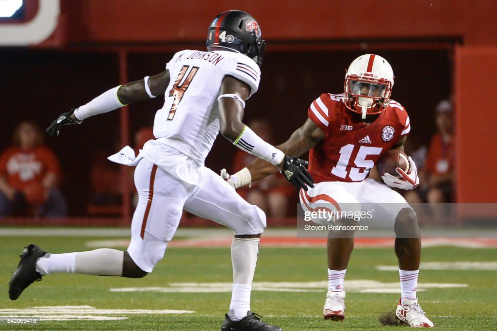 Wide receiver De'Mornay Pierson-El #15 of the Nebraska Cornhuskers avoids the tackle of defensive back Michael Johnson #4 of the Arkansas State Red Wolves at Memorial Stadium on September 2, 2017 in Lincoln, Nebraska.