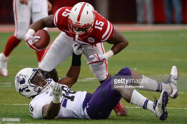 Wide receiver De'Mornay PiersonEl of the Nebraska Cornhuskers tries to leap over safety Godwin Igwebuike of the Northwestern Wildcats at Memorial...