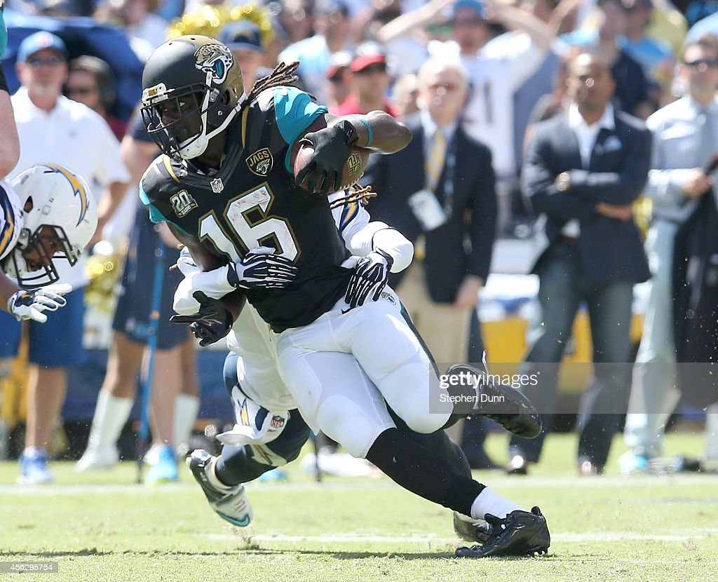 Wide receiver Denard Robinson #16 of the Jacksonville Jaguars carriews the ball against the San Diego Chargers at Qualcomm Stadium on September 28, 2014 in San Diego, California.