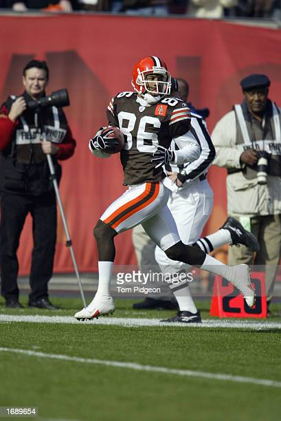 Wide receiver Dennis Northcutt of the Cleveland Browns returns Pittsburgh's Josh Miller's punt 87 yards for a touchdown to give them an early 70 lead...