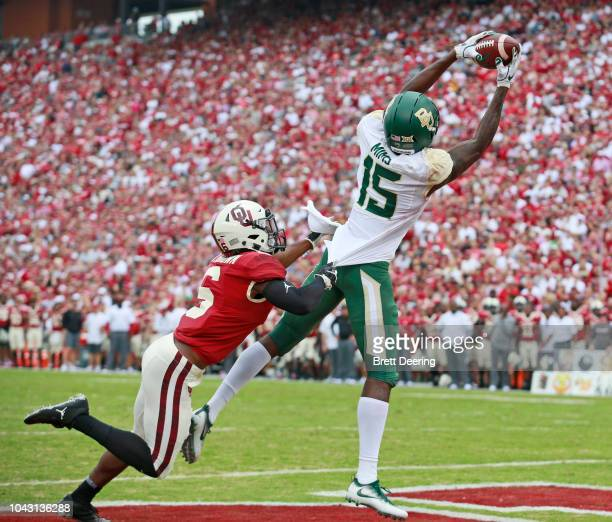 Wide receiver Denzel Mims of the Baylor Bears catches a touchdown in front of cornerback Tre Brown of the Oklahoma Sooners at Gaylord Family Oklahoma...