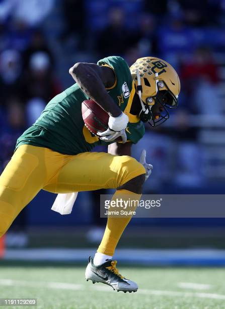 Wide receiver Denzel Mims of the Baylor Bears makes a catch during the game against the Kansas Jayhawks at Memorial Stadium on November 30 2019 in...