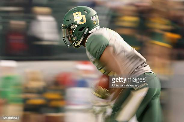 Wide receiver Denzel Mims of the Baylor Bears returns a kick off against the Boise State Broncos during the second quarter of the Motel 6 Cactus Bowl...