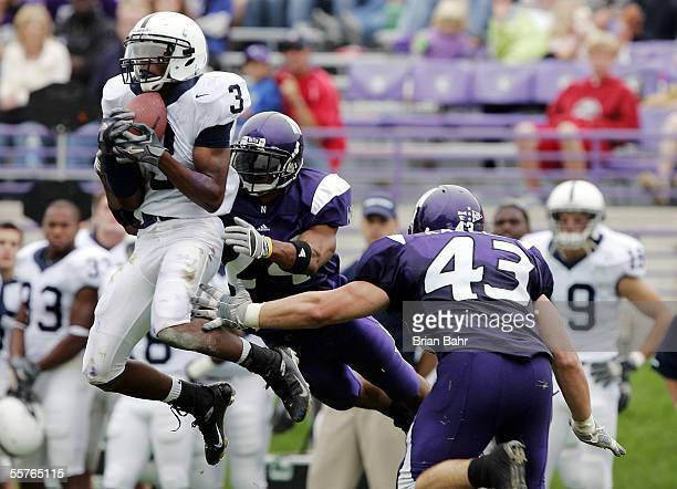 Wide receiver Deon Butler of the Penn State Nittany Lions grabs a 13-yard pass against safety Herschel Henderson of the Northwestern Wildcats with...