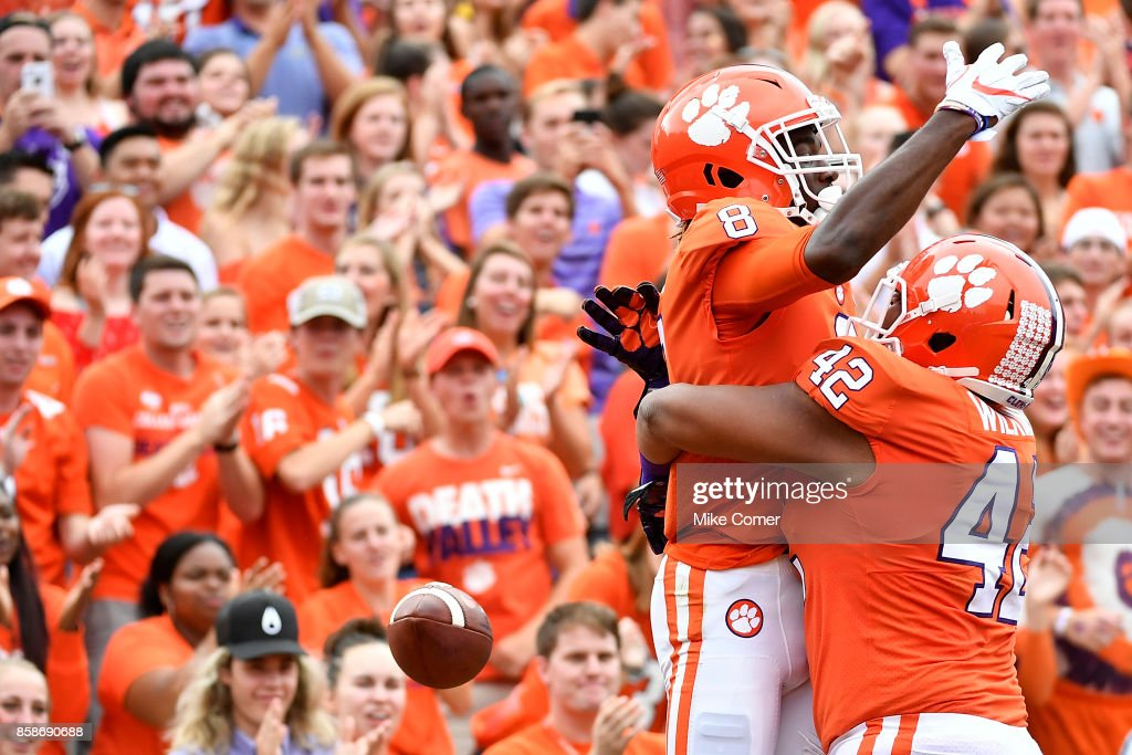 Wide receiver Deon Cain #8 of the Clemson Tigers celebrates with Christian Wilkins #42 of the Clemson Tigers after making a touchdown reception during the game at Memorial Stadium on October 7, 2017 in Clemson, South Carolina.