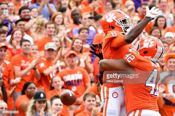 Wide receiver Deon Cain of the Clemson Tigers celebrates with Christian Wilkins of the Clemson Tigers after making a touchdown reception during the...