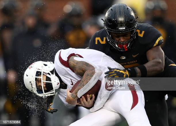 Wide receiver Deon Stewart of the Arkansas Razorbacks is hit by defensive back DeMarkus Acy of the Missouri Tigers after making a catch during the...