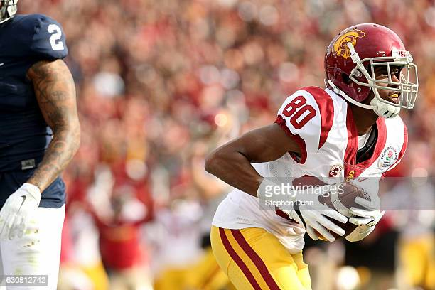 Wide receiver Deontay Burnett of the USC Trojans celebrates after catching a 26-yard touchdown in the first quarter against the Penn State Nittany...