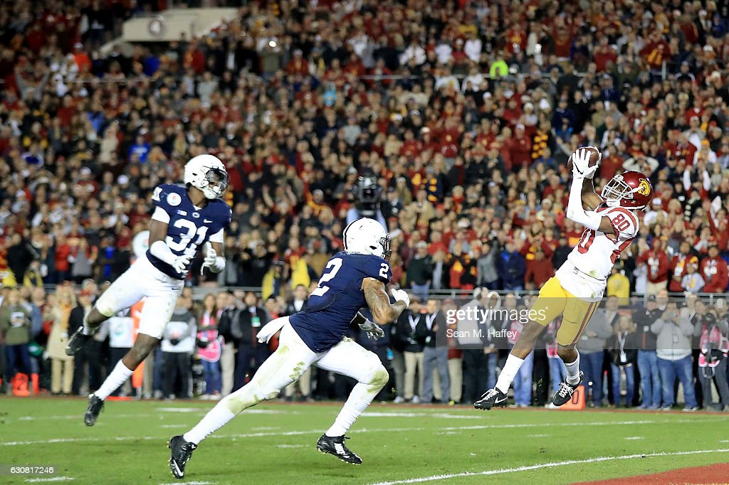 Wide receiver Deontay Burnett #80 of the USC Trojans scores a 27-yard touchdown in the fourth quarter against the Penn State Nittany Lions during the 2017 Rose Bowl Game presented by Northwestern Mutual at the Rose Bowl on January 2, 2017 in Pasadena, California.