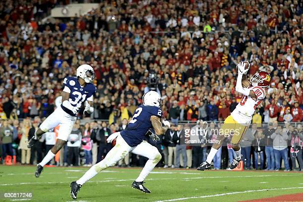 Wide receiver Deontay Burnett of the USC Trojans scores a 27yard touchdown in the fourth quarter against the Penn State Nittany Lions during the 2017...