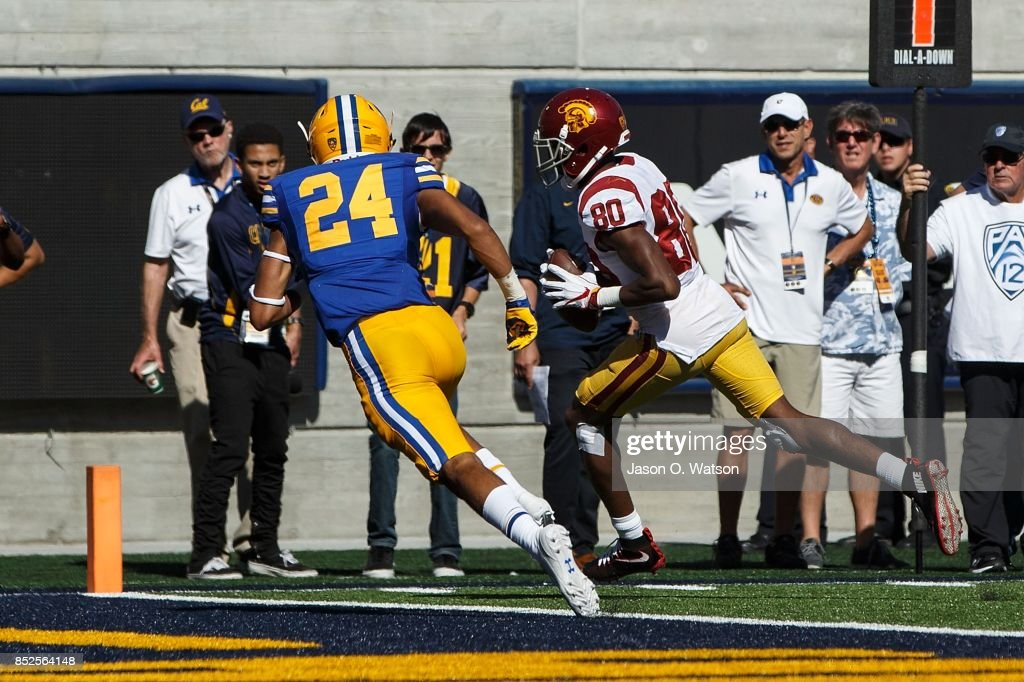 Wide receiver Deontay Burnett #80 of the USC Trojans scores a touchdown against the California Golden Bears during the fourth quarter at California Memorial Stadium on September 23, 2017 in Berkeley, California. The USC Trojans defeated the California Golden Bears 30-20.