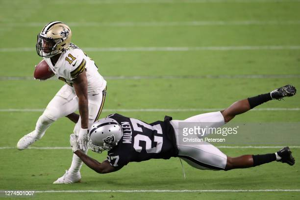 Wide receiver Deonte Harris of the New Orleans Saints avoids a tackle from cornerback Trayvon Mullen of the Las Vegas Raiders during the second half...