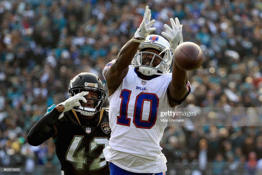 Wide receiver Deonte Thompson #10 of the Buffalo Bills misses a fourth quarter pass as strong safety Barry Church #42 of the Jacksonville Jaguars defends in the fourth quarter during the AFC Wild Card Playoff game at EverBank Field on January 7, 2018 in Jacksonville, Florida.