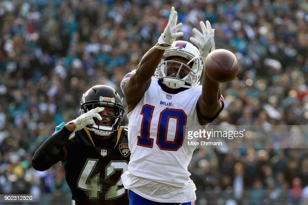 Wide receiver Deonte Thompson of the Buffalo Bills misses a fourth quarter pass as strong safety Barry Church of the Jacksonville Jaguars defends in...