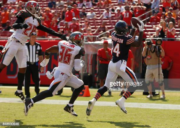 Wide receiver Deonte Thompson of the Chicago Bears catches a 14yard touchdown pass from quarterback Mike Glennon while getting pressure from...