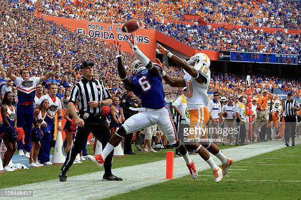 Wide receiver Deonte Thompson of the Florida Gators attempts a catch against defensive back Marsalis Teague of the Tennessee Volunteers during a game...