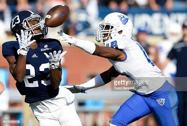 Wide receiver Derek Keaton of the Georgia Southern Eagles can't hold onto the ball as he's covered by cornerback Jerome Smith of the Georgia State...