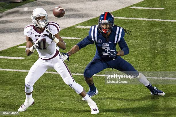 Wide receiver Derel Walker of the Texas AM Aggies prepares to catch a pass in front of defensive back Charles Sawyer of the Ole Miss Rebels dunning...