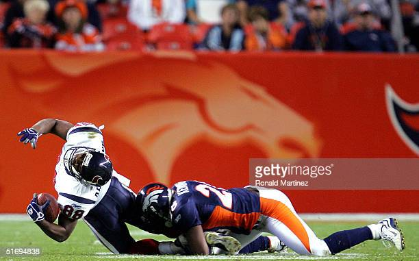 Wide receiver Derick Armstrong of the Houston Texans is tackled by Kenoy Kennedy of the Denver Broncos on November 7 2004 at Invesco Field at Mile...