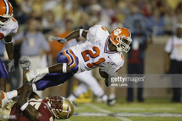 Wide receiver Derrick Hamilton of the Clemson Tigers dives for extra yardage on a punt return during the Atlantic Coast Conference football game...