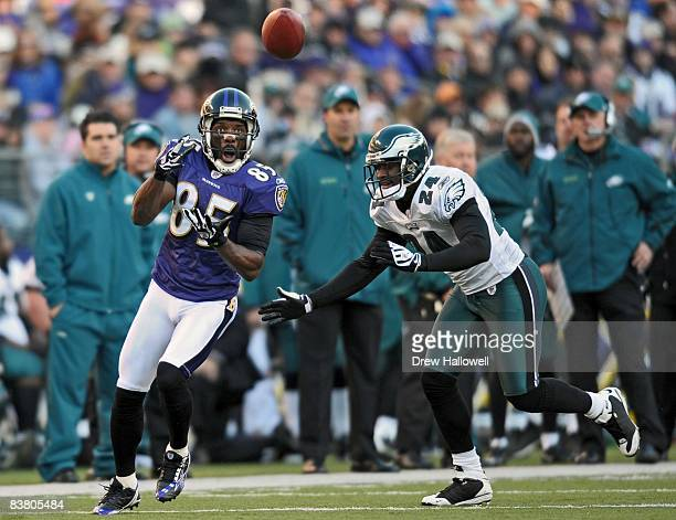 Wide receiver Derrick Mason of the Baltimore Ravens catches a pass in front of cornerback Sheldon Brown of the Philadelphia Eagles on November 23,...