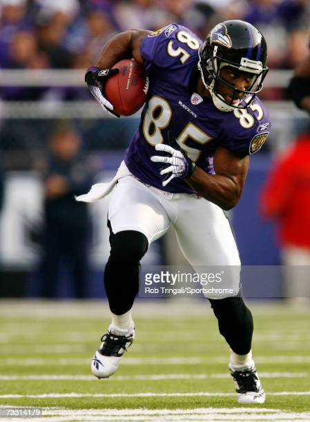 Wide Receiver Derrick Mason of the Baltimore Ravens runs with the ball while being defended by Sean Jones of the Cleveland Browns at M&T Bank Stadium...