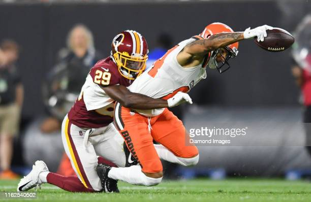 Wide receiver Derrick Willies of the Cleveland Browns is tackled by cornerback D.J. White of the Washington Redskins in the third quarter of a...