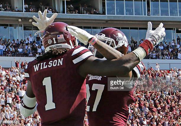 Wide receiver De'Runnya Wilson celebrates with running back Aeris Williams of the Mississippi State Bulldogs after he scored a touchdown during the...
