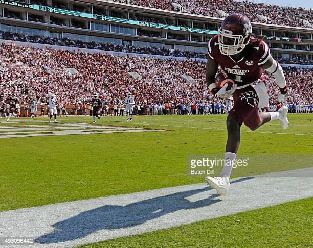 Wide receiver De'Runnya Wilson of the Mississippi State Bulldogs catches a pass for a touchdown during the second half of an NCAA college football...