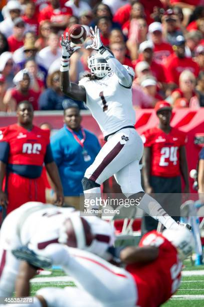 Wide receiver De'Runnya Wilson of the Mississippi State Bulldogs attempts to catch a pass during their game against the South Alabama Jaguars on...
