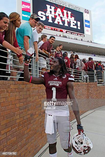 wide receiver De'Runnya Wilson of the Mississippi State Bulldogs celebrates with fans after defeating the Troy Trojans in a NCAA college football...