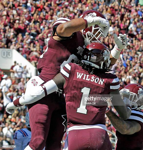 Wide receiver De'Runnya Wilson of the Mississippi State Bulldogs celebrates with tight end Darrion Hutcherson after he scored a touchdown during the...