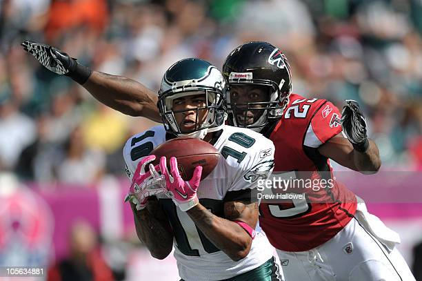 Wide Receiver DeSean Jackson of the Philadelphia Eagles catches a pass for his second touchdown of the game with safety William Moore of the Atlanta...