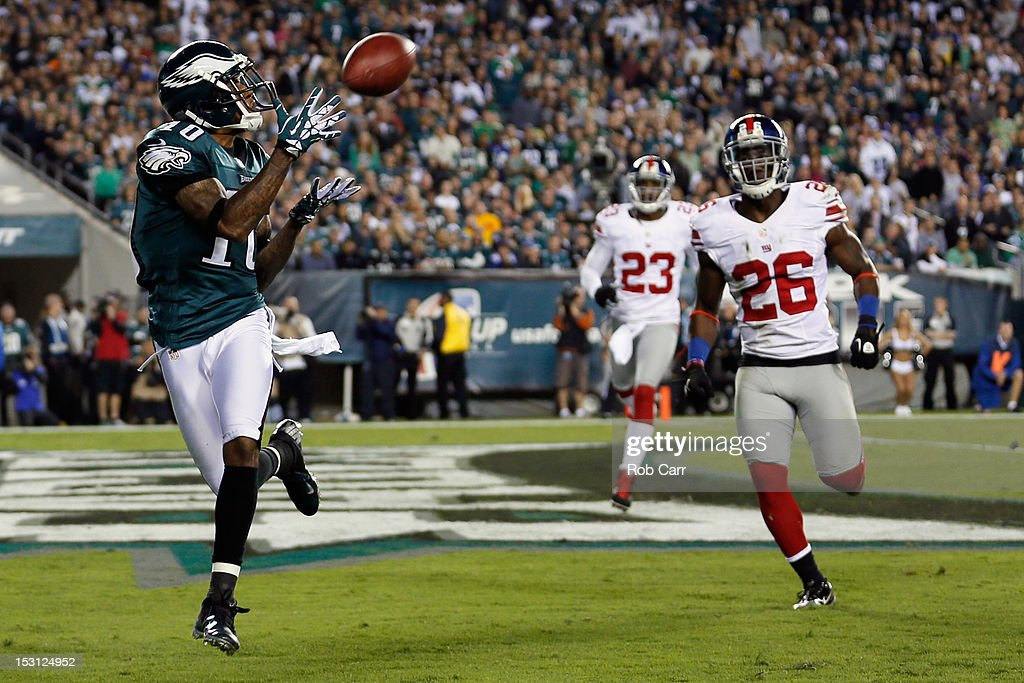 Wide receiver DeSean Jackson #10 of the Philadelphia Eagles catches a touchdown pass in front of free safety Antrel Rolle #26 of the New York Giants during the second quarter at Lincoln Financial Field on September 30, 2012 in Philadelphia, Pennsylvania.