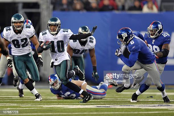 Wide Receiver DeSean Jackson of the Philadelphia Eagles evades punter Matt Dodge of the New York Giants and returns a punt for a touchdown and the...