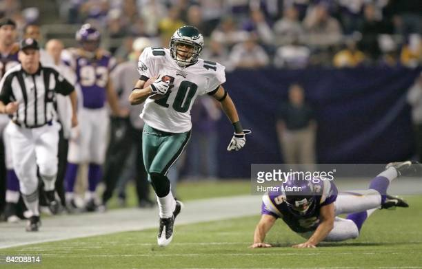 Wide receiver DeSean Jackson of the Philadelphia Eagles returns a punt as punter Chris Kluwe of the Minnesota Vikings pursues during the NFC Wild...