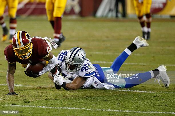 Wide receiver DeSean Jackson of the Washington Redskins is tackled by strong safety Barry Church of the Dallas Cowboys in the second quarter at...