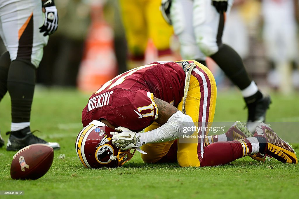 Wide receiver DeSean Jackson #11 of the Washington Redskins reacts after taking a hit in the second half of a game against the Tampa Bay Buccaneers at FedExField on November 16, 2014 in Landover, Maryland.